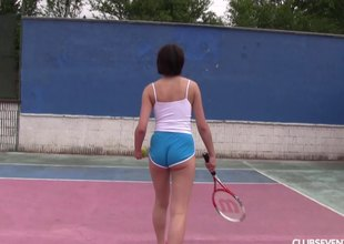 Tennis girl fingers her wet pussy while out on the court