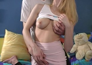 Slender blonde with large boobs object her pink snatch licked