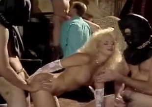 This sex crazed blonde loves being close to hammer away middle of a spitroast
