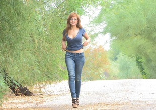 Redhead honey approximately glasses and jeans love to camp-ground her nice butt and natural tits approximately public