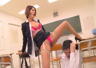 Slutty teacher gets gangbanged by the guys in her class