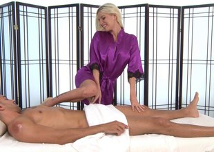 Busty blonde takes off her silk poncho and sucks a dude's hard cock