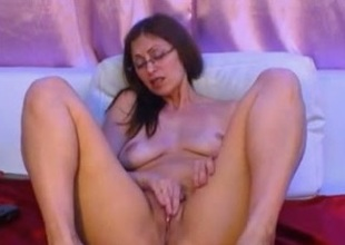 Big-assed milf in glasses fingers say no to cooch in webcam solo show