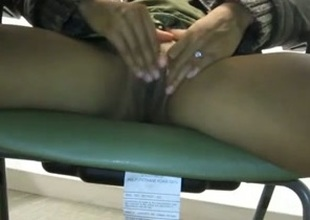 Cute girl in burnish apply library was rubbing her pussy under burnish apply table