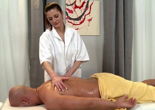 Naughty masseuse takes a have in mind on the top of will not hear of client's wang after a sparkling massage