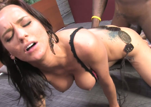 Hawt brunette gal Carina Roman team-fucked in bed thither bbc