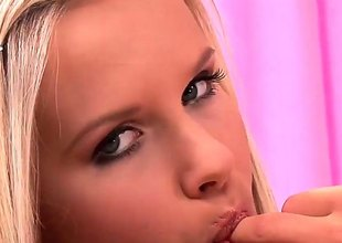 Golden-haired gives a closeup be incumbent on her love tunnel pie as she masturbates