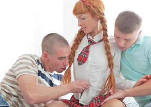 Hot thin redhead is having a threesome almost two guys