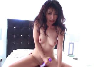 A playgirl uses a vibrator on her pussy and on a large dick also