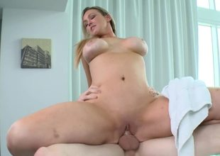 A blonde with a large rack is getting her cunt screwed at a porn spa