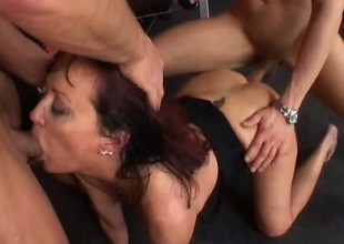 In the gym, a lickerish mature woman gets pounded hard wits 2 juvenile chaps