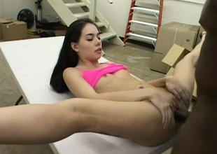 Petite obscurity with sexy long legs and small tits surrenders her cunt forth a black cock