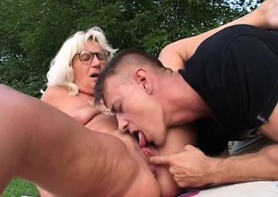 Excited granny is specified to fucking younger guys with stiff dicks