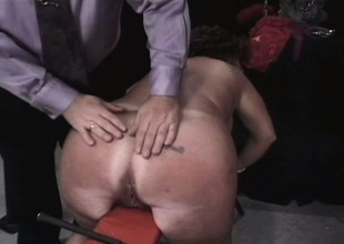 Chunky age-old brunette takes some torture on her tits and exasperation in the dungeon