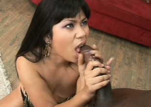 Hot Asian slut gobbles up a big black, fucks him, and sucks out his cum
