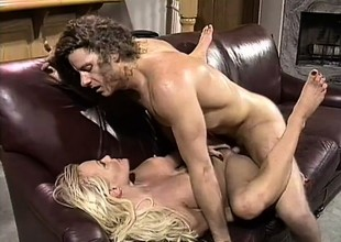 Close to her sexy feet and her hot lips, a wild blonde gets a big cock skinned for action