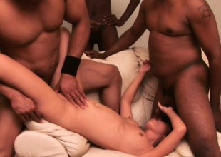 Juvenile East slut has four gloomy men inculcation her twat and covering her face near cum