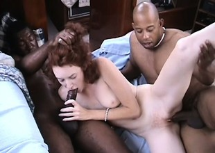 Redhead loves having her pierced pussy fucked by big swarthy cocks
