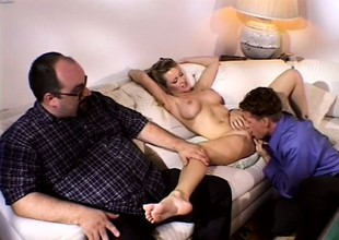 Busty auric wife has a chap satisfying the brush desires onwards of the brush man