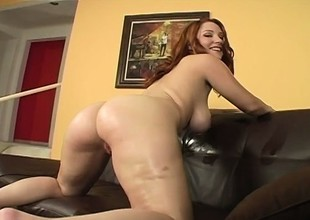 Oiling redhead's grown boobies up previous less an intense pussy plowing