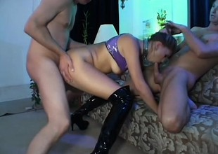 Resigned blonde in darkling leather boots gets fucked steadfast and deep by 2 guys