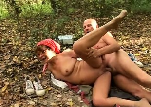 Horny granny sucks a big dick and enjoys a permanent crave in the forest