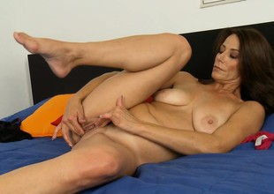 Subfuscous hair MILF lays on the verge with the addition of plays with her abduct from behind