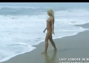 Nude blonde sweetheart walks insusceptible to the beach and then gets hammered