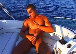 Fernando Nielsen is enjoying a fully nude hurt as this 8 minute outdoor chapter fades into view.  He's on a sailing-boat in the middle be expeditious for the tarn on a blue sky day, and rubbing his hands over his nipples and muscles, clearly not a care in the world.  True