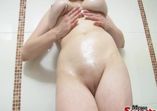Yummy chubby natural tits coated in slippery oil