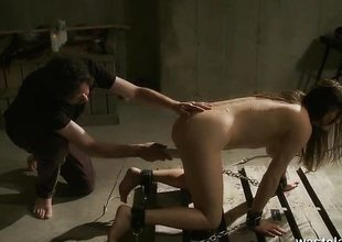 Undressed slave given orgasms by Authority on dungeon floor