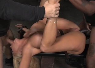Bimbo in thraldom used by a bowels of horny guys