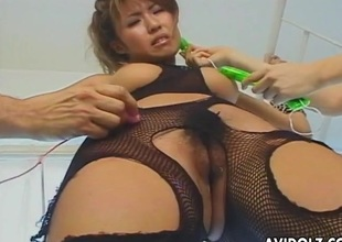 Bound Japanese girl in fishnet underthings receives vibrated