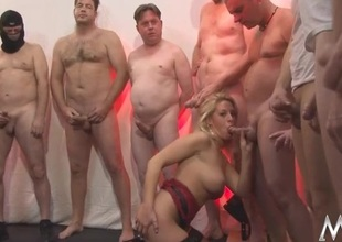 Males are lined up to receive sucked by a milf slut
