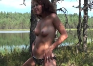 Amateur sweetheart in a swimsuit strips by eradicate affect lake