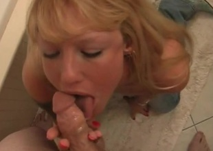 Cock and ball worshipping milf in the bathroom