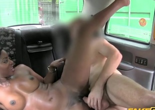 Charming dark ecumenical fucked in a taxi cab