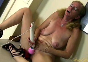Big red dildo in a soaking wet older wet hole