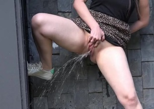 Curvy babe does a drenched piss upon public