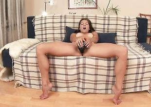 Brunette Monchi positions playfully before masturbating
