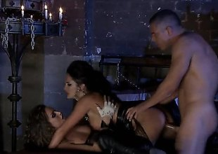 Alektra Blue and Tori Malicious are in a threesome with a dude in a oubliette that is only lit by candles. They are doing some servitude in this sexy and amazing scene.