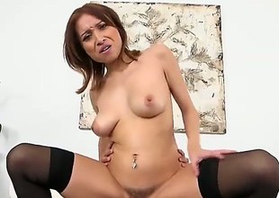 Adessa Winters is a brunette babe in dark stockings and shes plan to ride on his hard and long, white, king sized dong. She loves em big an hard!