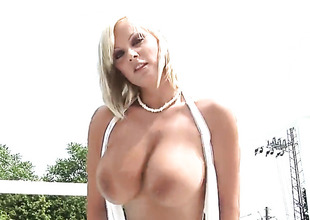 Sheila Grant with huge tits and bald snatch gives pleasure about herself the way she can't live without it