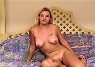 Lovely blond masturbates with a toy before riding on a phony pecker roughly