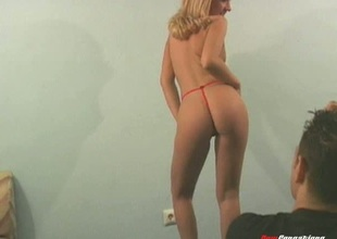 Blonde model nigh a tantalizing naked photo shoot ahead of a rough doggystyle throbbing