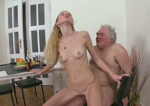Skinny blond show one's age fucks her BF with an increment of his old grand-dad