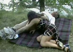 This nasty chick is blowing an aged fart's pecker outdoors