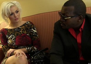 A black guy works a white girl's pussy nearby his long cock