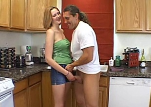 Diminutive amateur babe with natural interior milking a blarney in the kitchen