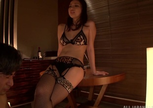 Japanese brunette in bra coupled with stockings performs hot handjob